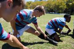 Close up of sports people exercising at grassy field Stock Images