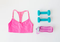 Close up of sports top, dumbbells and bottle Royalty Free Stock Photography
