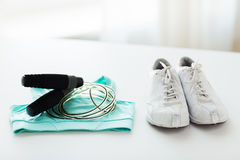 Close up of sports top, sneakers and skipping rope Stock Images