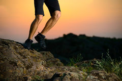Close-up of Sportsman's Legs Running on the Rocky Mountain Trail at Night. Active Lifestyle Royalty Free Stock Photography