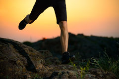 Close-up of Sportsman's Legs Running on the Rocky Mountain Trail at Night. Active Lifestyle Stock Photography