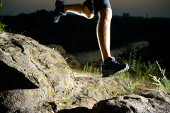 Close-up of Sportsman's Legs Running on the Rocky Mountain Trail at Night. Active Lifestyle Royalty Free Stock Photos