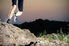 Close-up of Sportsman's Legs Running on the Rocky Mountain Trail at Night. Active Lifestyle Stock Images