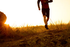 Close-up of Sportsman's Legs Running on the Rocky Mountain Trail at Sunset. Active Lifestyle Stock Photo