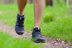 Close-up of Sportsman's Legs Walking on the Trail in the Wood. Active Lifestyle. Concept Royalty Free Stock Photos