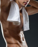 Close up of sportsman's torso. Isolated on black Royalty Free Stock Image