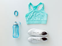 Close up of sportswear, bracelet and bottle Royalty Free Stock Images