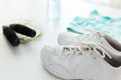 Close up of sportswear, skipping rope and bottle Royalty Free Stock Photography