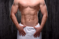 Close up of sporty man with towel on hips Royalty Free Stock Images