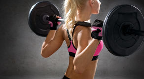 Close up of sporty woman exercising with barbell Royalty Free Stock Photos