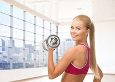 Close up of sporty woman flexing her bicep Stock Images