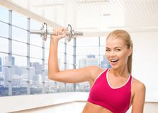 Close up of sporty woman flexing her bicep Stock Photo