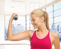Close up of sporty woman flexing her bicep Royalty Free Stock Photo