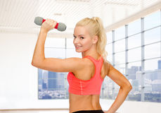 Close up of sporty woman flexing her bicep Stock Image
