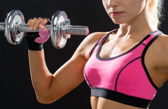 Close up of sporty woman with heavy steel dumbbell Stock Images