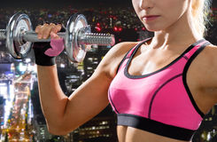 Close up of sporty woman with heavy steel dumbbell Royalty Free Stock Photos