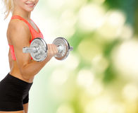 Close up of sporty woman with heavy steel dumbbell Royalty Free Stock Image