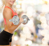 Close up of sporty woman with heavy steel dumbbell Stock Photos