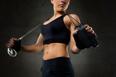 Close up of sporty woman with jumping rope Royalty Free Stock Photo