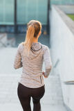Close up of sporty woman running downstairs Royalty Free Stock Photo