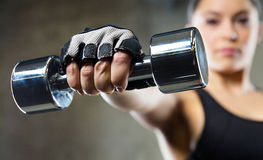 Close up of sporty woman with steel dumbbell Stock Photos