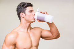 Close-up of a sporty young man drinking protein Stock Photo