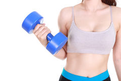 Close up of sporty young woman training with dumbbell Stock Photo