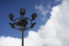 Close up of Spot lights tower on blue sky and clouds with copy space, natural color picture style image,selective focus Royalty Free Stock Images