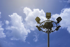 Close up of Spot lights tower on blue sky and clouds with copy space, natural color picture style image,selective focus Royalty Free Stock Photography