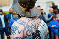 Close up of spqr tattoo on man dressed as roman soldier during a march in rome. Man in roman soldier costum with spqr tattoo Stock Images