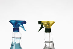 Close up of spray bottles against white background Royalty Free Stock Photography