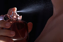 Close up of spray. On woman body isolated black Royalty Free Stock Photography