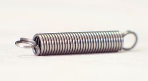 Close up of a spring coil. With depth of field stock photos