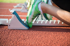 Close-up of sprinter feet in starting block.  Stock Photography