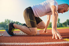 Close-up of sprinter feet in starting block.  Royalty Free Stock Photography