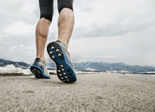 Close up sprinter legs on asphalt Stock Image