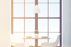 Close up of a square cafe table with two white chairs standing near a window and a light wooden wall. 3d rendering, toned image Royalty Free Stock Images