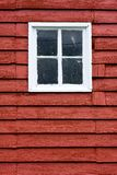 Close up square white window inred wooden barn. Royalty Free Stock Photo