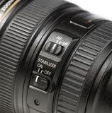 Close up stabilizer button on lens Royalty Free Stock Photography