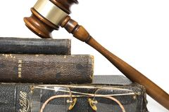 Close Up Three Antique Bibles with Gavel and Rimless Glasses on. Close Up of Stack of Antique Leather Bibles with Wooden Gavel and Glasses royalty free stock photo