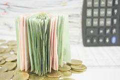 Close up stack bill over gold coins Royalty Free Stock Photo