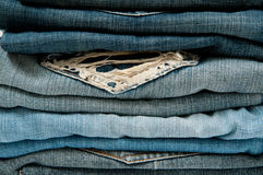 Close up Stack Blue Jeans. In cabinet Royalty Free Stock Images