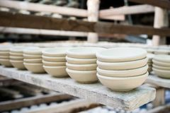 Close up clay pottery ceramic products dry on shelf royalty free stock photography