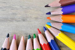Close up stack color pencils on wooden background Stock Photography