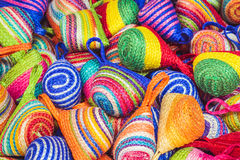 Close up stack of colorful handmade coin bag in market Stock Photography
