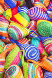 Close up stack of colorful handmade coin bag in market Royalty Free Stock Images