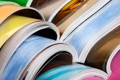 Close-up of stack of colorful magazines Stock Photography
