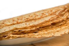 Close up on a stack of crepes french pancakes on a plate, white background. Close up on a stack of crepes french pancakes on a plate on white background royalty free stock image