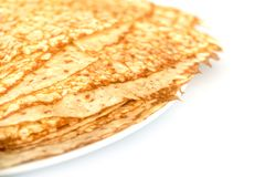 Close up on a stack of crepes french pancakes on a plate on white. Close up on a stack of crepes french pancakes on a plate, white background royalty free stock photos