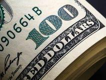 Close up of stack of 100 dollar bills. Close up of stack of one hundred dollar bills royalty free stock image